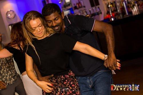 Couple dancing Semba on a dance floor