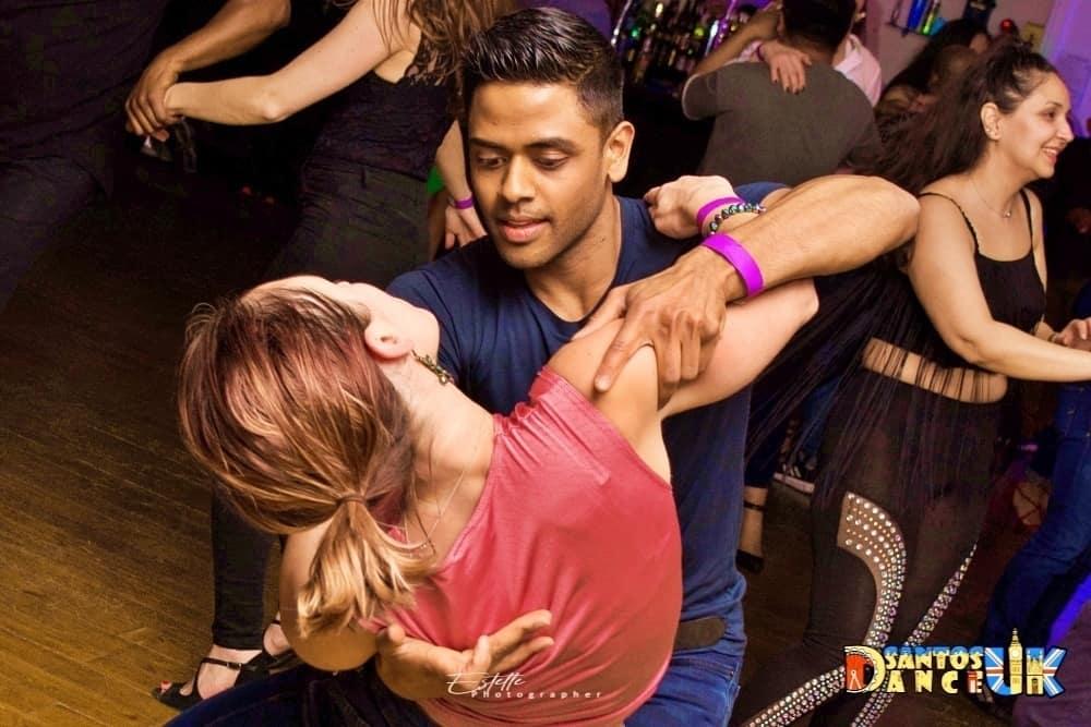 Man leaning woman when dancing bachata class at RV Dance school studio