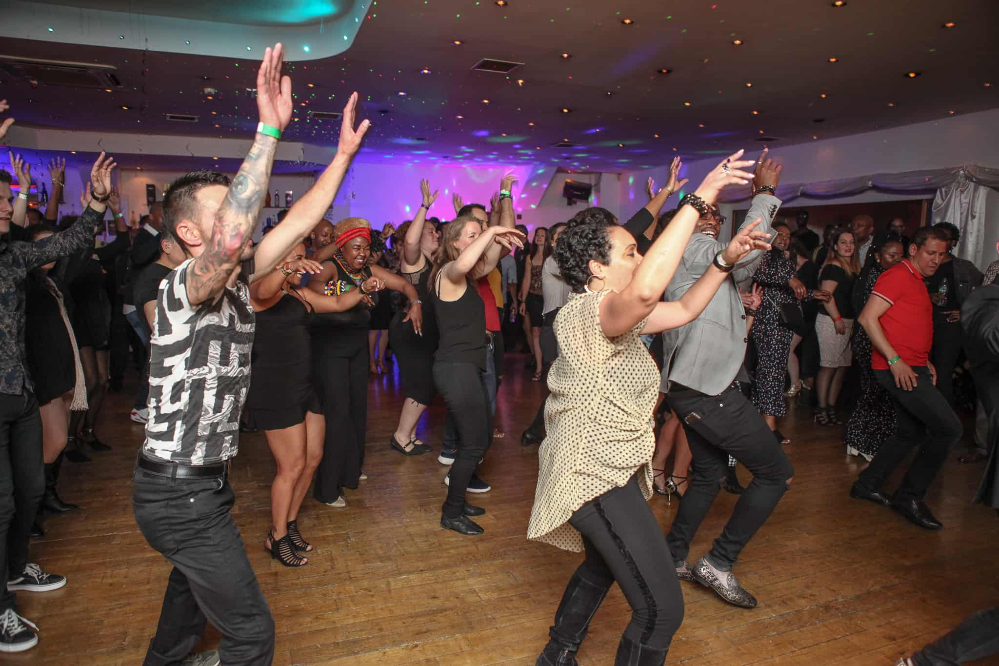 Group of people dancing at kizomba party in London
