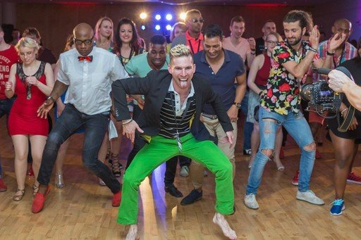 Richard Voogt leads students while dancing afro house