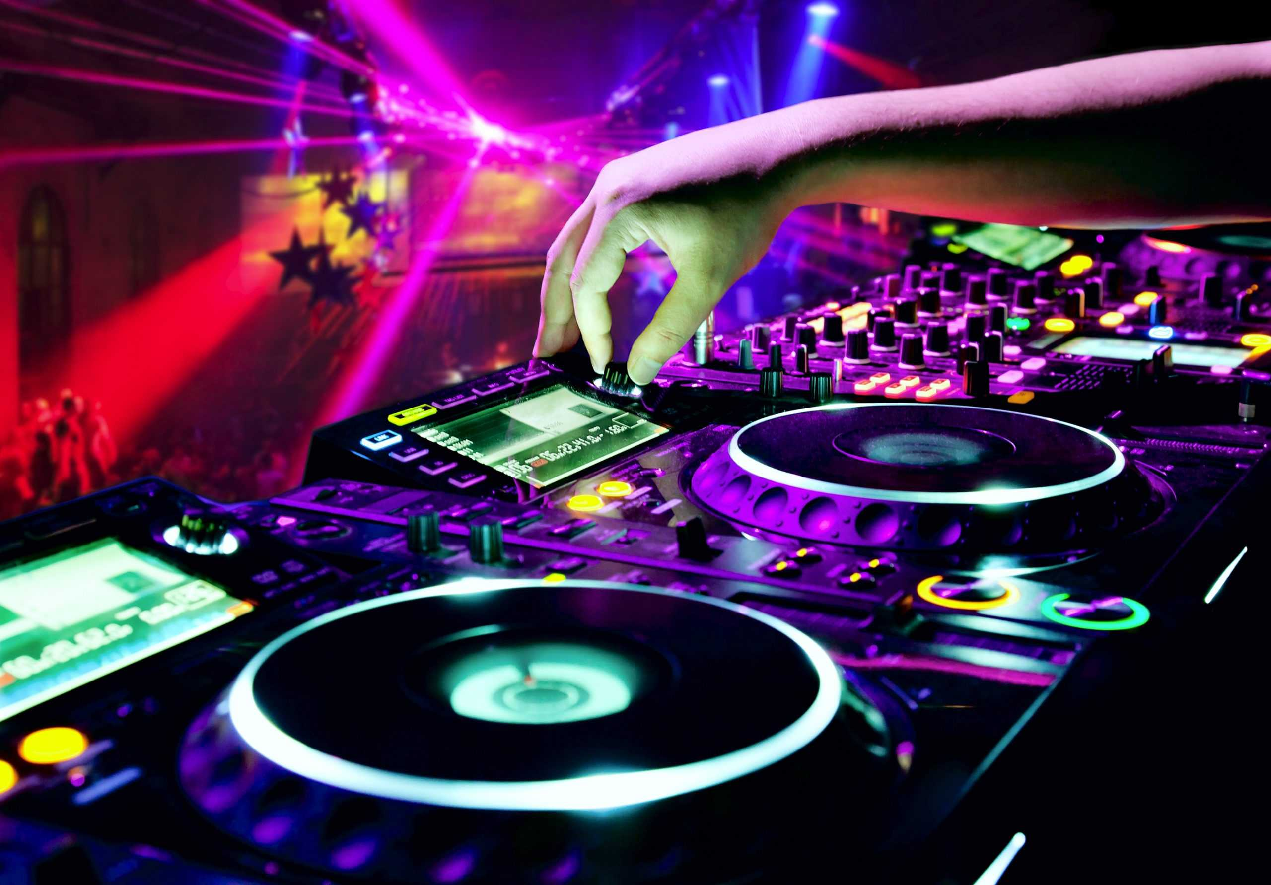Image of DJ set with a bright colourful lightening on the background