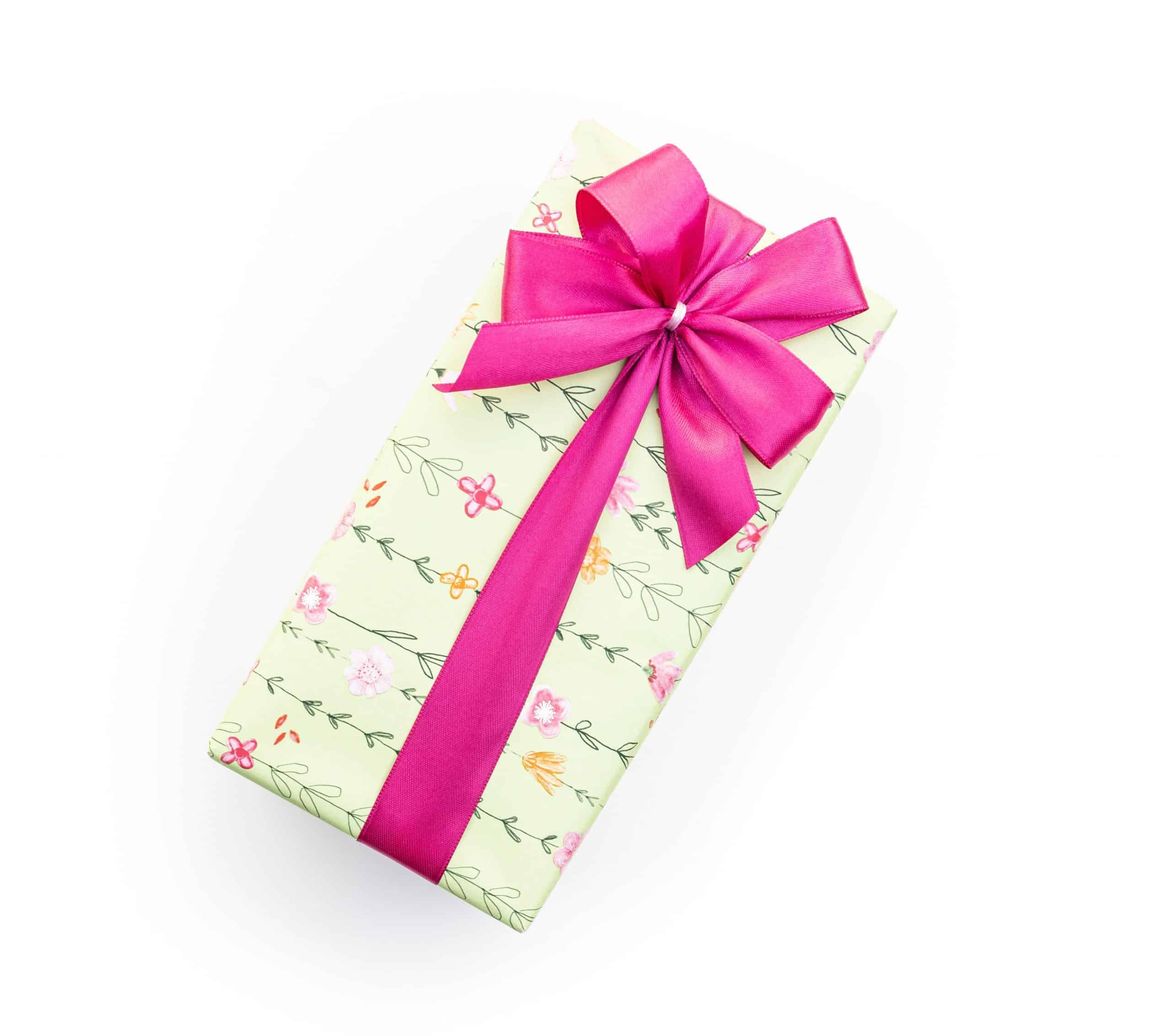 Gift box with a pink ribbon