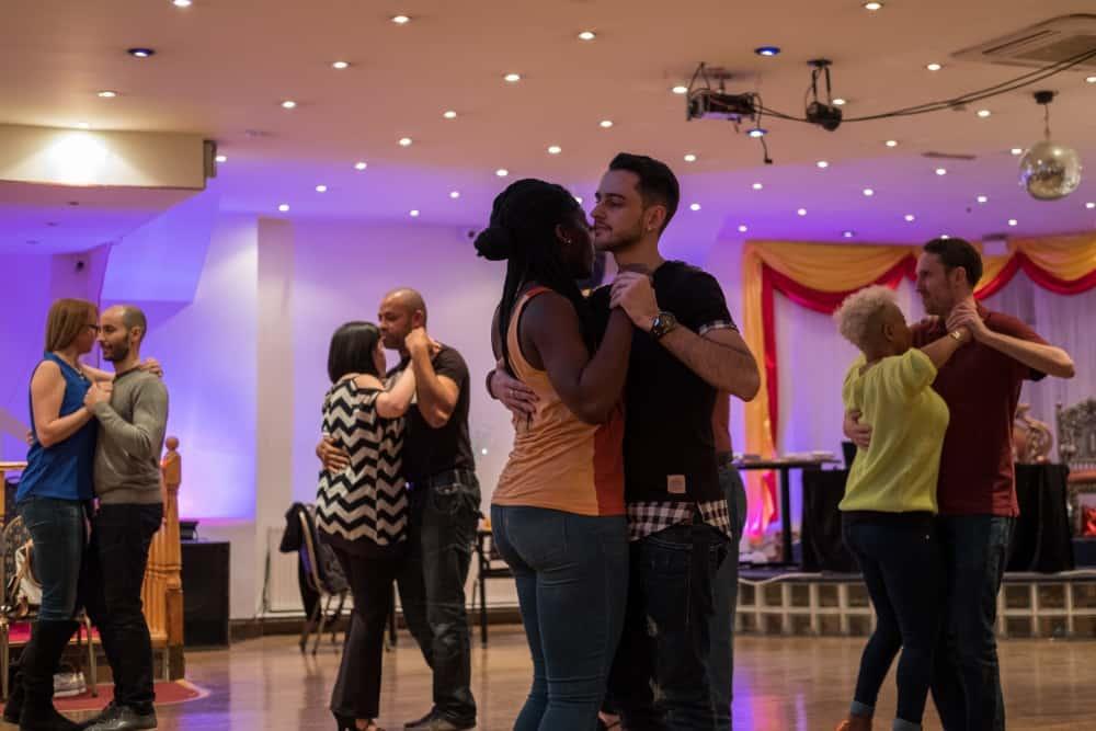 Kizomba dance lesson where couples exercise dancing technique
