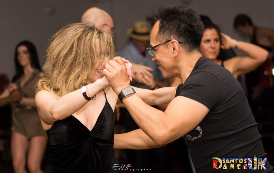 Couple dancing Salsa in motion