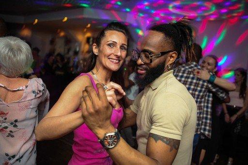 Women smiling while dancing Kizomba dance