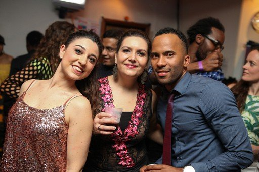 Woman and a man posing for a picture at a Drena Kizomba night