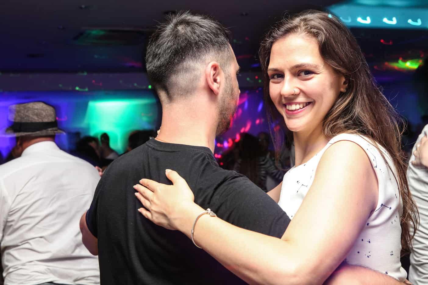 women smiling while dancing