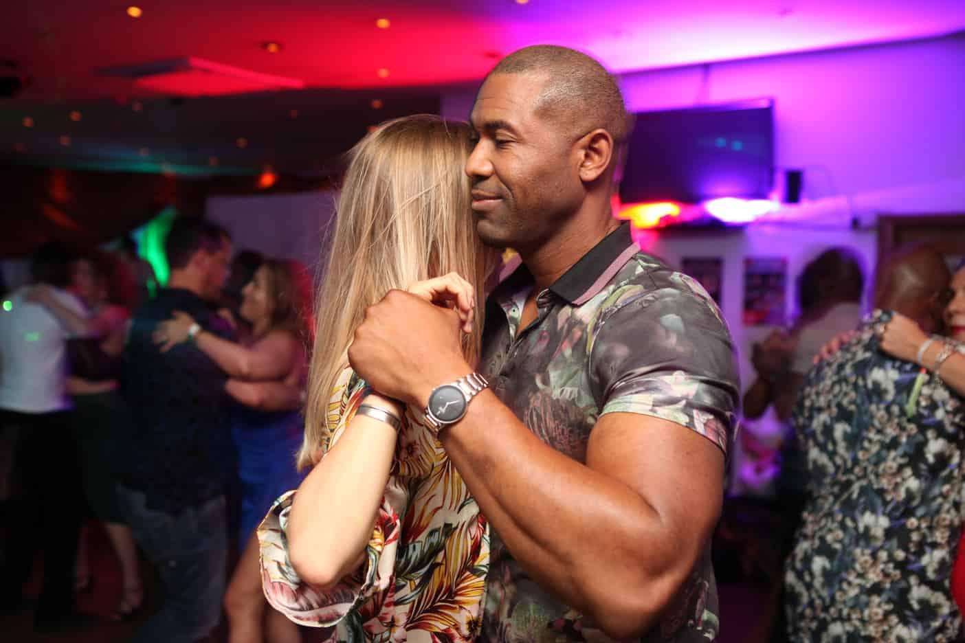 Man holding women's hand while dancing Kizomba